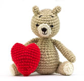 Lonely bear doll with heart Stock Images