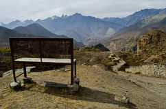 A lonely bech on the long way. A lonely bench on the mountain view Royalty Free Stock Photos