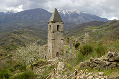 Lonely bell tower in ruins. In the abandoned village of Morino near Avezzano in central Italy royalty free stock photo