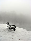 Lonely bench. In winter fog Stock Photo