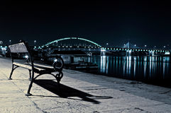Lonely bench. At the night. Selective focus on the wooden bench Royalty Free Stock Image