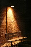 Lonely Bench. A bench under a spot light at night Stock Photo