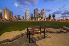 Lonely bench against the  Tel Aviv. Royalty Free Stock Photos