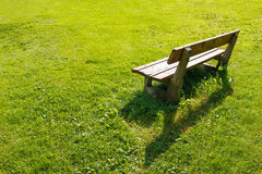 Lonely bench in backyard. Stock Image
