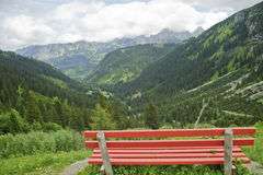 Lonely bench with beautiful mountain scenery Royalty Free Stock Photo