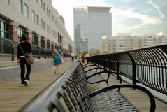 Lonely bench in busy place Royalty Free Stock Photos