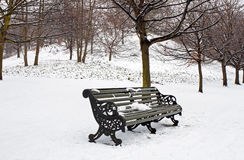 A lonely bench covered in deep snow Stock Photos