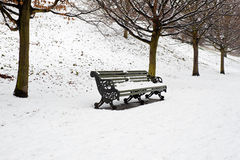 A lonely bench covered in deep snow Royalty Free Stock Photos