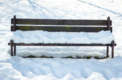 Lonely Bench Covered by Snow Royalty Free Stock Photos