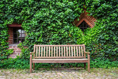 Lonely bench in green Stock Photography