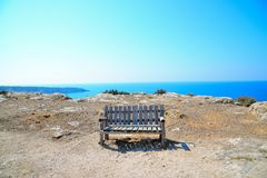 Lonely bench on the hill. At San Nicola island, Tremiti, Italy Royalty Free Stock Image