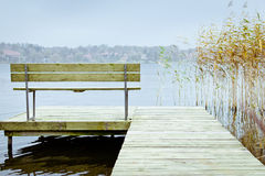 Lonely bench at lake Royalty Free Stock Photos