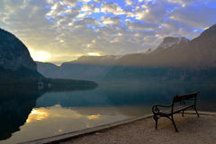 Lonely bench looking to Hallstatt lake. A Lonely bench looking to Hallstatt lake Stock Images