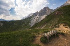 Lonely bench with mountain views stock photo