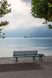 Lonely bench overlooking the lake Maggiore Royalty Free Stock Photography
