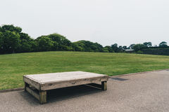 Lonely bench in a park Stock Photo