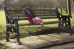 Lonely bench. Bench lonely scarf park garden spring date expectation waiting sad urban landscape one close-up Stock Photo