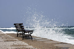 A lonely bench by the sea. A lonely bench by the stormy sea in chania Royalty Free Stock Photography