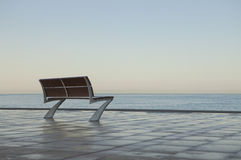 Lonely Bench by the Sea Royalty Free Stock Photos