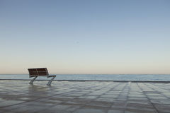Lonely Bench by the Sea Stock Photography