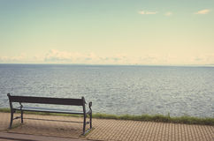 The lonely a bench on the seafront. Royalty Free Stock Photos