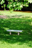 Lonely Bench. A lonely bench sitting by a creek in Fredericksburg Texas Stock Photo