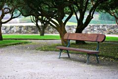 Lonely bench. Solitary bench in a park in springtime in A Coruña, Galicia Stock Photography