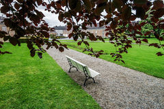 Lonely bench in spring park Stock Images
