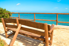 Lonely bench on a viewing platform with views of the sea. Back view Royalty Free Stock Photos