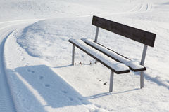 Lonely bench in a winter landscape Stock Photo