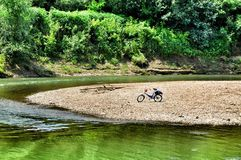 Lonely bicycle on the coast river Psekups Stock Image
