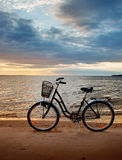 Lonely bike standing at sunset Stock Photo