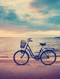 Lonely bike standing at sunset Stock Image