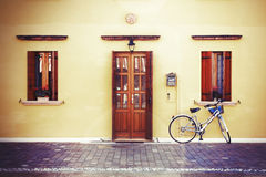 Lonely bike by wall Stock Image