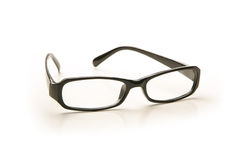 Lonely black glasses on a white background Royalty Free Stock Photo