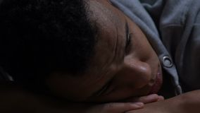 Lonely black guy suffering depression, thinking about life, lack of friends. Stock footage stock video