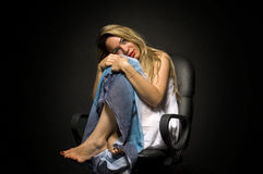 Lonely blonde woman Stock Photo