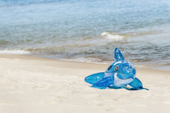 Lonely blue inflatable dolphin on the beach. Toy on the beach Royalty Free Stock Images