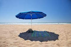 Lonely blue parasol Stock Photography