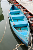 Lonely blue rowboat Stock Photography