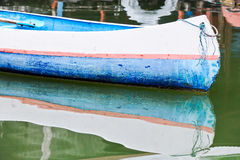 Lonely blue rowboat Stock Photos