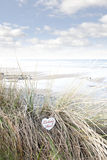 Lonely blue wooden heart on beach dunes Royalty Free Stock Photos