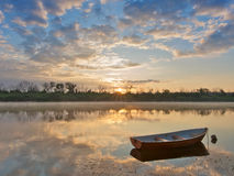 Lonely boat. Early morning on a river. Landscape with boat royalty free stock image