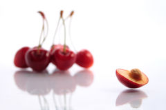 Lonely boat. Few cherries and a cherry separately Stock Photo