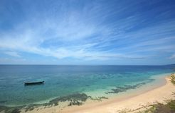 Lonely boat. Over transparent sea water. Indonesia Stock Photos