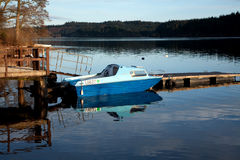 Lonely Boat. A small boat on a calm Scottish Loch stock photo