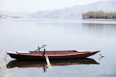 Lonely boat. In early spring,a lonely boat on the river Royalty Free Stock Images