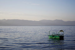 Lonely boat. Boat, lake and horison, sky, heaven stock photos