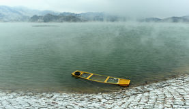 A lonely boat. In micro cold winter, a boat anchored by the lake Royalty Free Stock Images