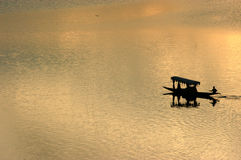 Lonely Boat. A lonely boat in a lake royalty free stock photography